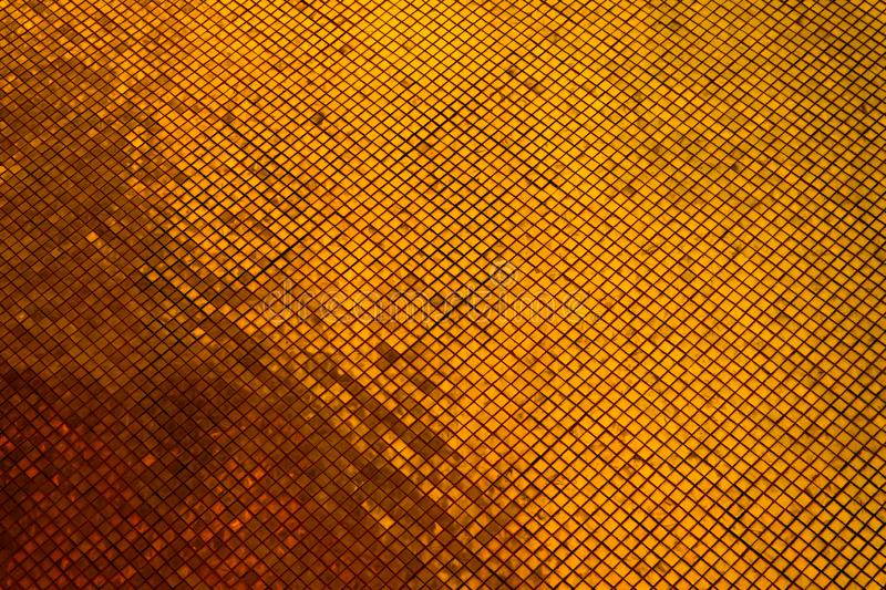 Beautiful closeup textures abstract tiles and black gold and yellow color glass pattern wall background and art wallpaper. S royalty free stock photo