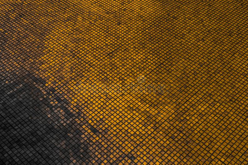 Beautiful closeup textures abstract tiles and black gold and yellow color glass pattern wall background and art wallpaper. S royalty free stock images