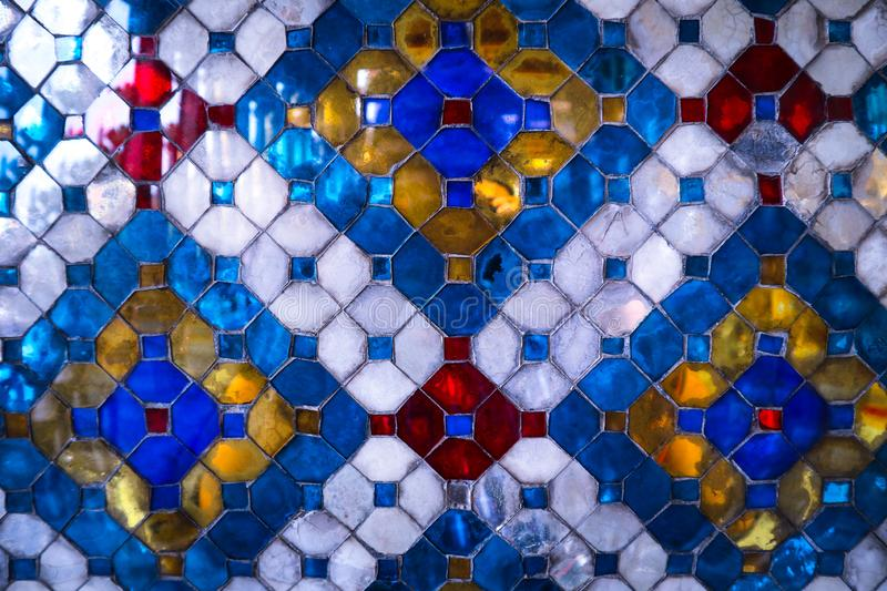 Beautiful closeup textures abstract tiles and gold and colorful glass wall background and art. Beautiful closeup textures abstract tiles and gold and green red royalty free stock image
