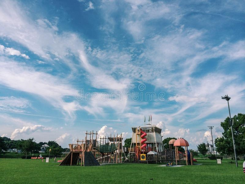 Beautiful cloud formation in kids playground stock photography