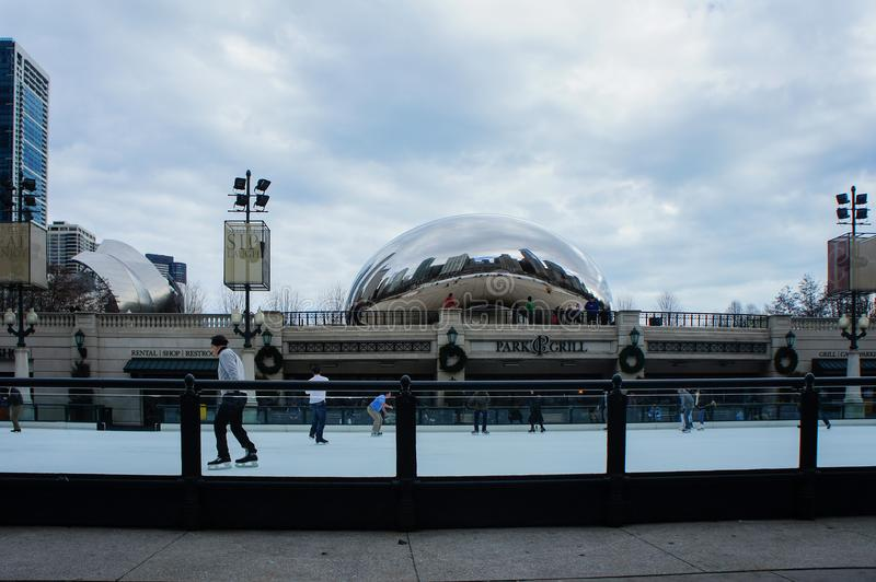 The beautiful Cloud Gate and ski area at Millennium Park, Chicago, Illinois. Chicago, JAN 31: The beautiful Cloud Gate and ski area on JAN 31, 2012 at Millennium royalty free stock image