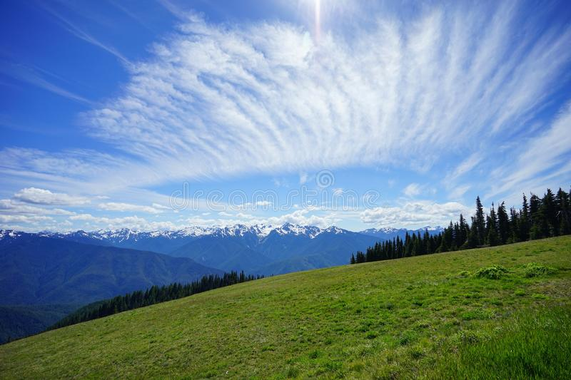 Beautiful cloud over snow capped mountains in Olympic National Park in summer. In Washington, near Seattle stock photography