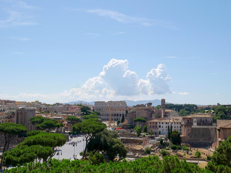 Beautiful clouds above coliseum, view of the Colosseum and the Roman Forum, Rome, Italy. stock photos