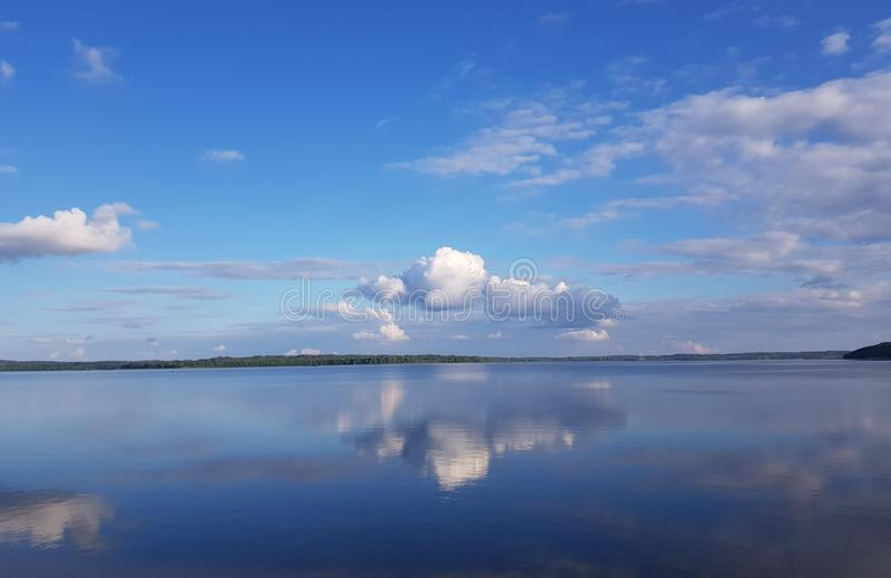 beautiful clouds above the lake royalty free stock photo