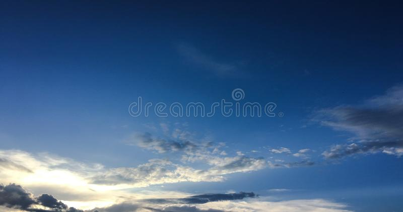 Beautiful clouds against a blue sky background. Cloudscape sky. Blue sky with cloudy weather, nature cloud. White clouds, blue sky. And sun royalty free stock photography