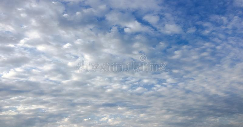 Beautiful clouds against a blue sky background. Cloudscape sky. Blue sky with cloudy weather, nature cloud. White clouds, blue sky. And sun royalty free stock photos