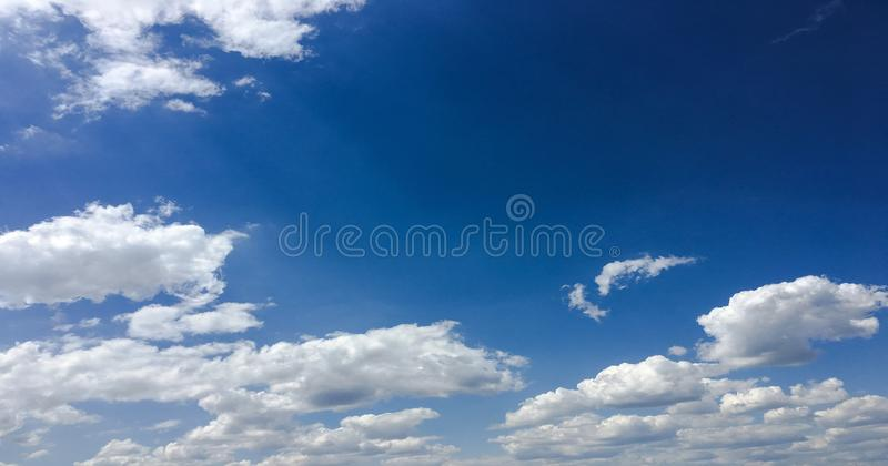 Beautiful clouds against a blue sky background. Cloudscape sky. Blue sky with cloudy weather, nature cloud. White clouds, blue sky. And sun stock photography