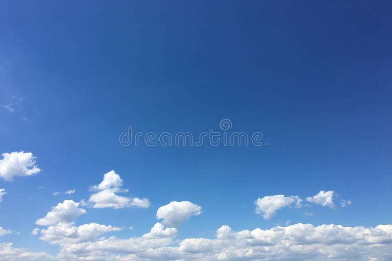 Beautiful clouds against a blue sky background. Cloudscape sky. Blue sky with cloudy weather, nature cloud. White clouds, blue sky. And sun stock image
