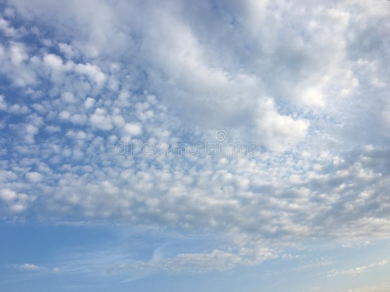 Beautiful clouds against a blue sky background. Cloudscape sky. Blue sky with cloudy weather, nature cloud. White clouds, blue sky. And sun stock photo