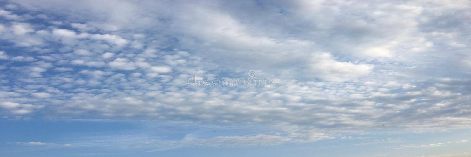 Beautiful clouds against a blue sky background. Cloudscape sky. Blue sky with cloudy weather, nature cloud. White clouds, blue sky. And sun stock photos