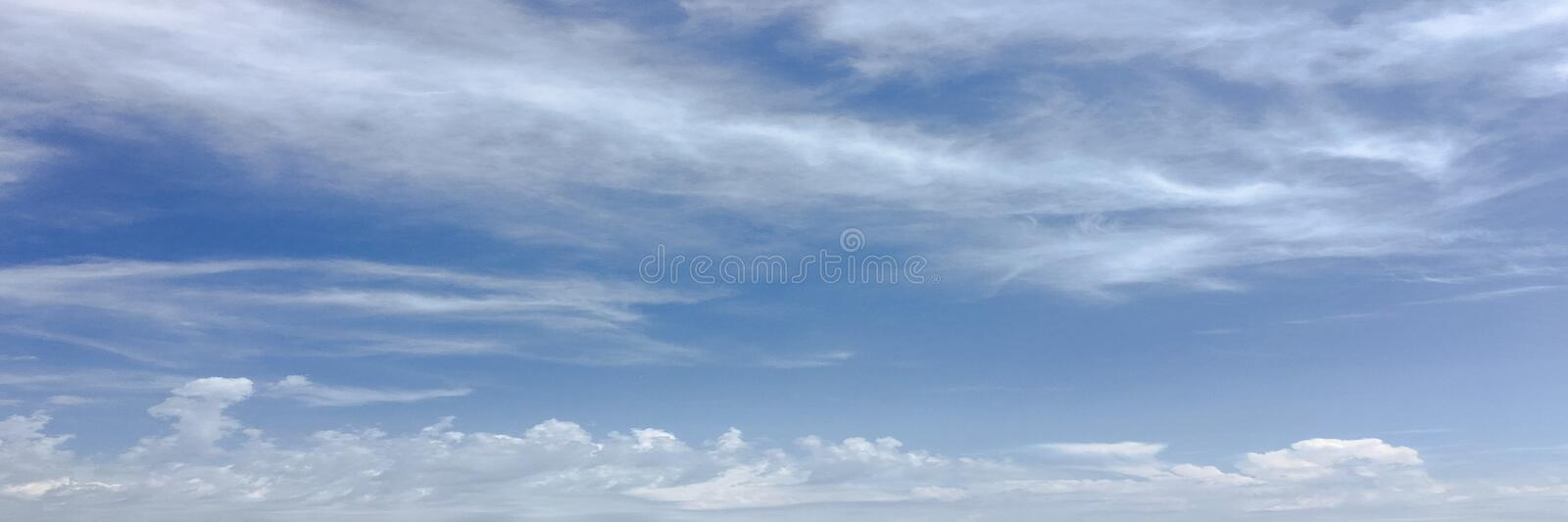 Beautiful clouds against a blue sky background. Cloudscape sky. Blue sky with cloudy weather, nature cloud. White clouds, blue sky. And sun royalty free stock photo