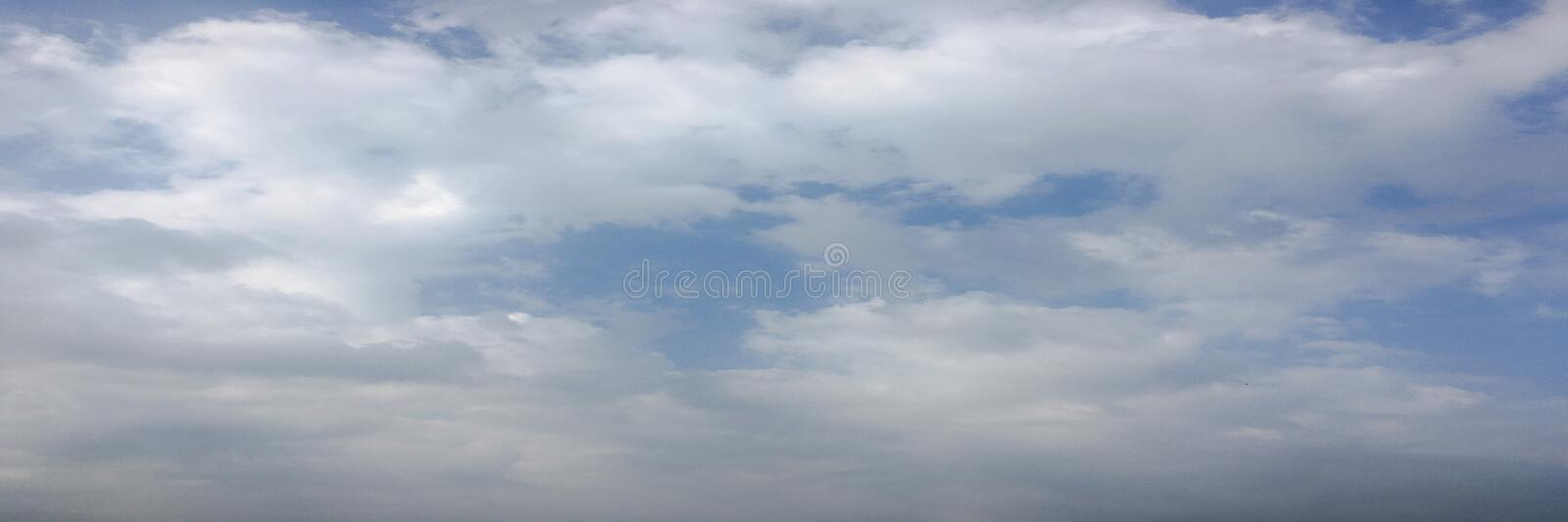 Beautiful clouds against a blue sky background. Cloudscape sky. Blue sky with cloudy weather, nature cloud. White clouds, blue sky. And sun royalty free stock image