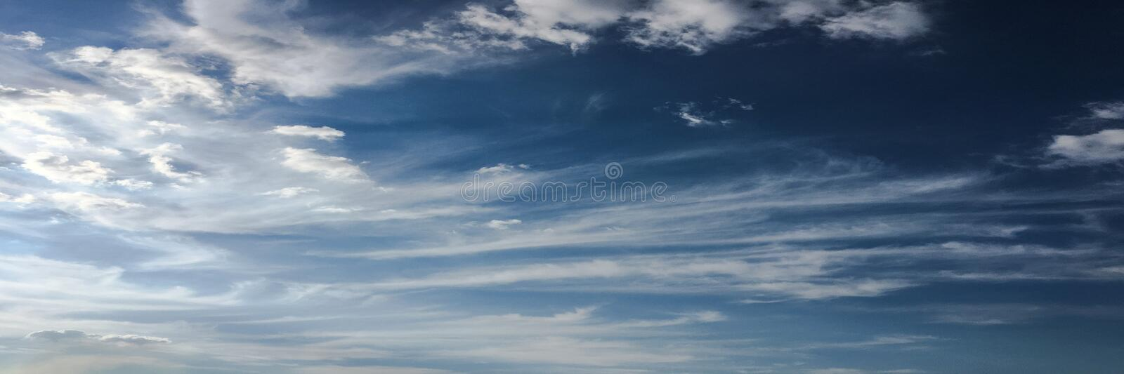 Clouds on blue sky background. Weather nature blue sky with white cloud and sun. royalty free stock image