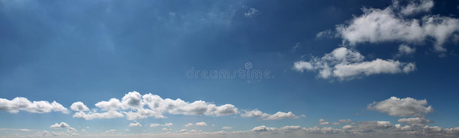 Beautiful clouds and blue sky panorama in high resolution royalty free stock photography