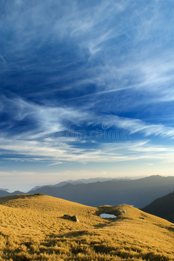 Beautiful clouds fly over the grassland royalty free stock image