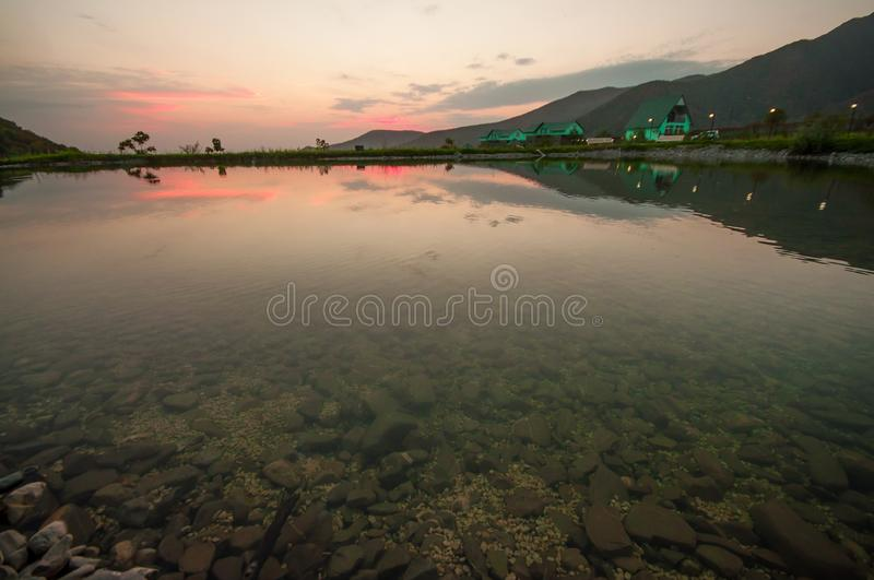 Beautiful clouds flying over the lake near mountains. Evening time shot over the clouds. Azerbaijan. Big Caucasus stock photos
