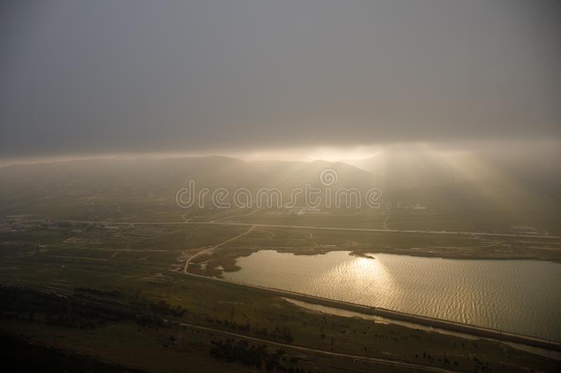 Beautiful clouds flying over the lake near mountains. Evening time shot over the clouds. Baku, Azerbaijan royalty free stock photography