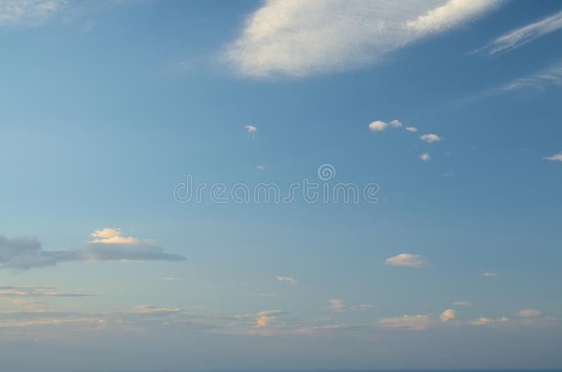 Beautiful clouds lit by the rising sun. Sky. Sunrise royalty free stock images