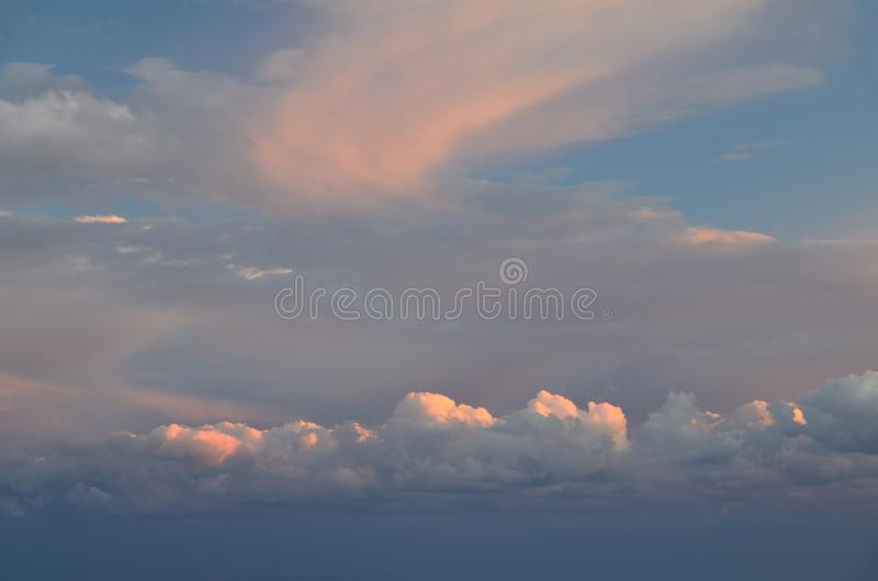 Beautiful clouds lit by the rising sun. Sky. Sunrise royalty free stock photography
