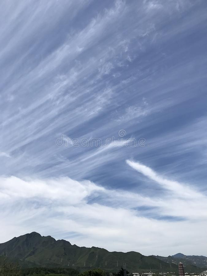 Beautiful clouds on the mountain. S royalty free stock photo