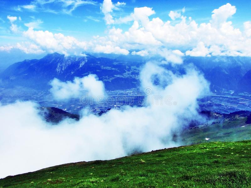 The beautiful clouds over the Alps and the river Rhine valley Rheintal. Canton of St. Gallen, Switzerland stock images