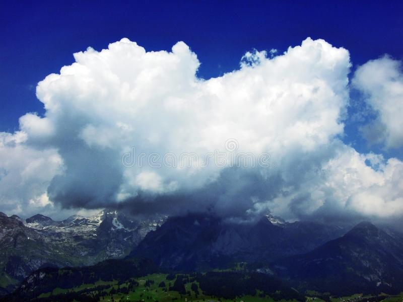The beautiful clouds over the Alps and the river Rhine valley Rheintal. Canton of St. Gallen, Switzerland royalty free stock photography