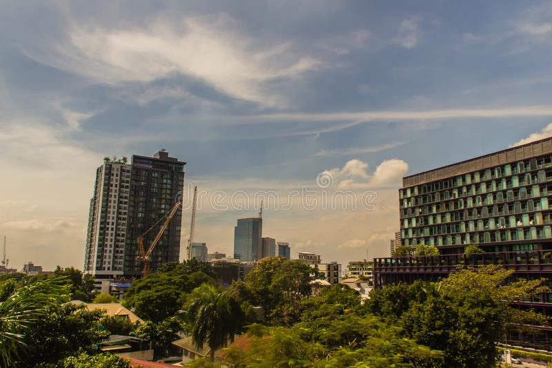 Beautiful clouds over Bangkok city. Exotic skyline city summer colorful blue sky with cityscape urban building and cloud sunset or royalty free stock images