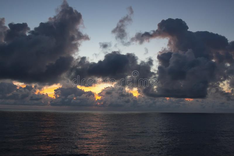 Beautiful clouds over the sea. Beautiful white clouds forming and moving in blue sky royalty free stock images