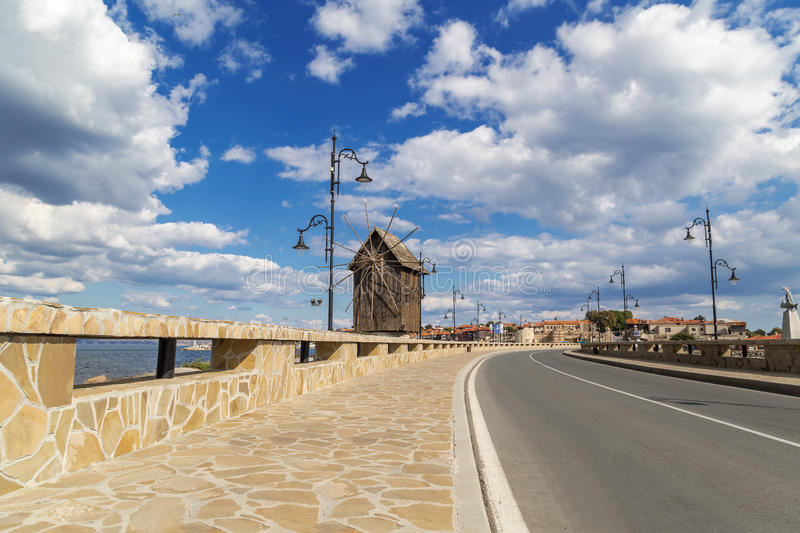 Beautiful clouds over the windmill in Nessebar stock image