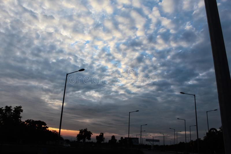 A beautiful clouds pattern clicked at the time of sunset. A beautiful clouds pattern clicked at the time of sunset in the evening on the highway stock photos