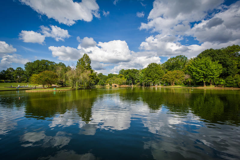 Beautiful clouds reflecting in the lake at Freedom Park, in Char. Lotte, North Carolina stock photography