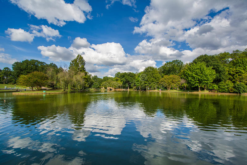 Beautiful clouds reflecting in the lake at Freedom Park, in Char. Lotte, North Carolina royalty free stock image