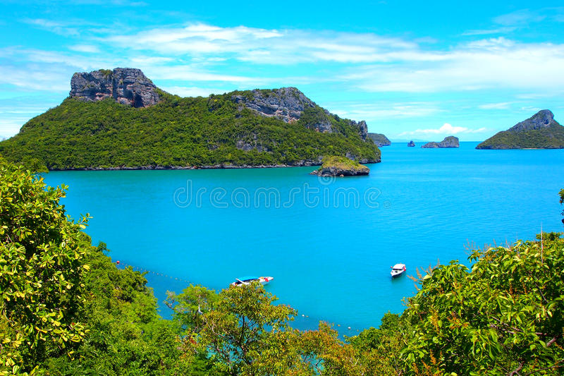 Beautiful clouds shores and blue ocean, mountin green trees stock image