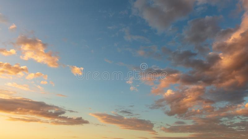 Beautiful clouds in the sky at sunset stock images