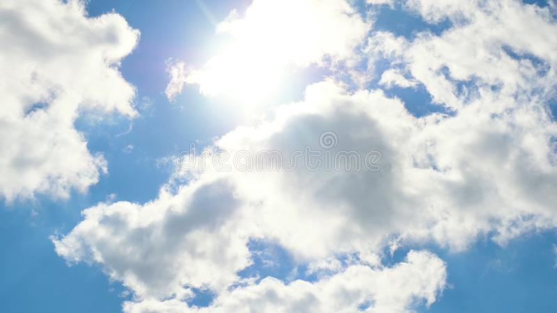 Beautiful cloudscape with large, building clouds and sunrise breaking through cloud mass royalty free stock photo