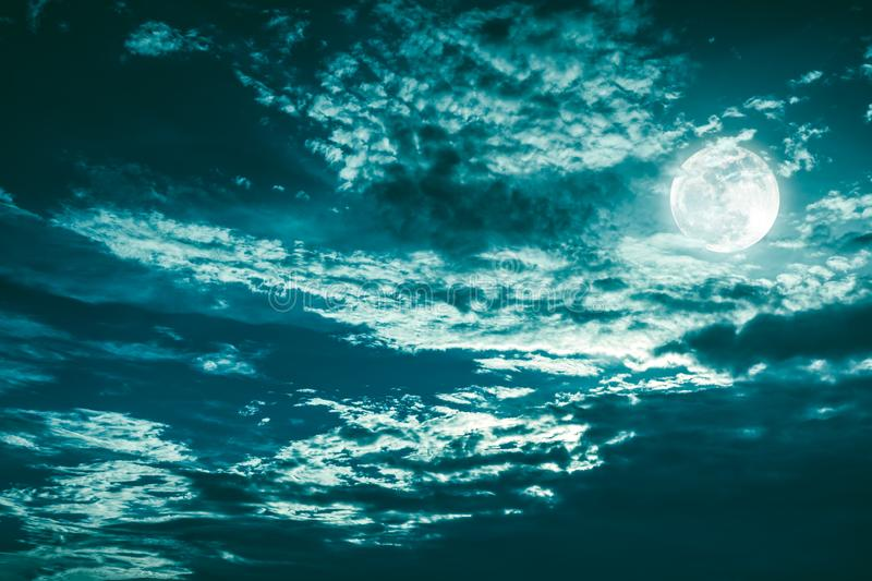 Beautiful cloudscape of night sky with dark cloudy. Some clouds overshadow the full moon. Serenity nature background in nighttime stock photo