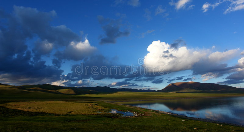 Beautiful cloudscape over lake stock photo