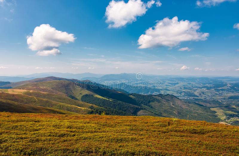 Beautiful cloudscape over the mountain meadow stock photo