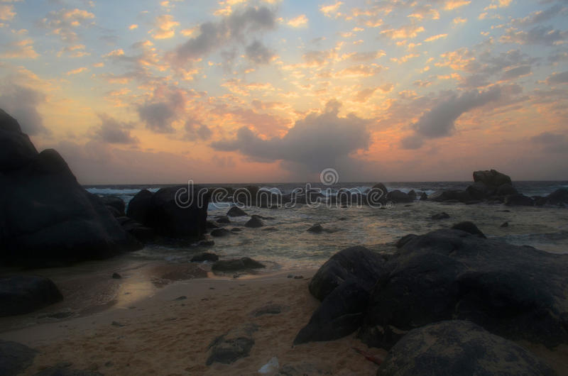 Beautiful Cloudy Skies in Aruba at Sunrise on the Beach royalty free stock image