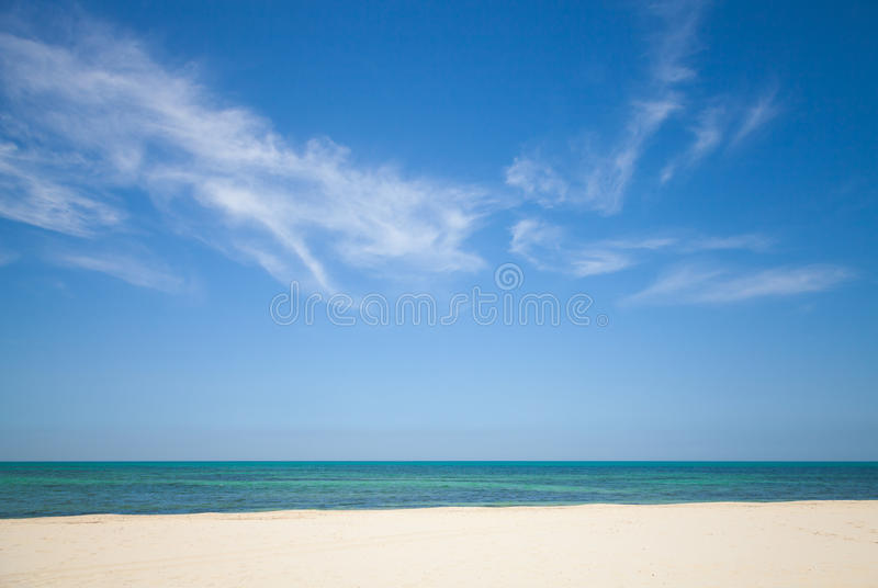 Beautiful cloudy sky over white sandy beach. Nature background stock image