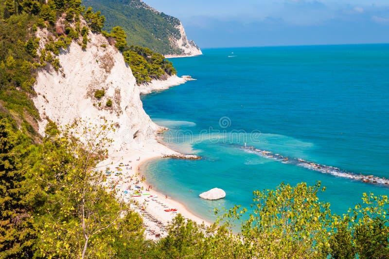 Beautiful coastline of Numana, Ancona, Italy surrounded by high massive white limestone rocky cliffs eroded by Adriatic sea waves. Beautiful coastline of Numana stock photo