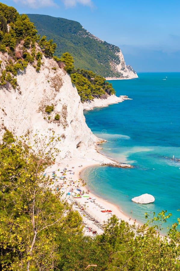Beautiful coastline of Numana, Ancona, Italy surrounded by high massive white limestone rocky cliffs eroded by Adriatic sea waves. Beautiful coastline of Numana royalty free stock images