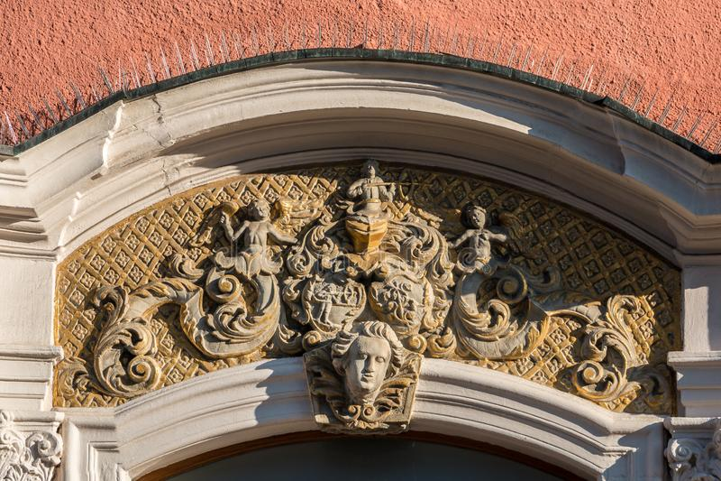 Beautiful coat of arms on a historical old building stock photo