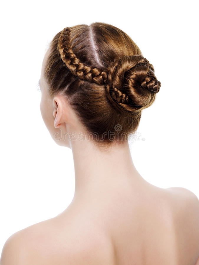 Beautiful coiffure from pigtails. Rear view of a beautiful coiffure from pigtails. On white background stock image
