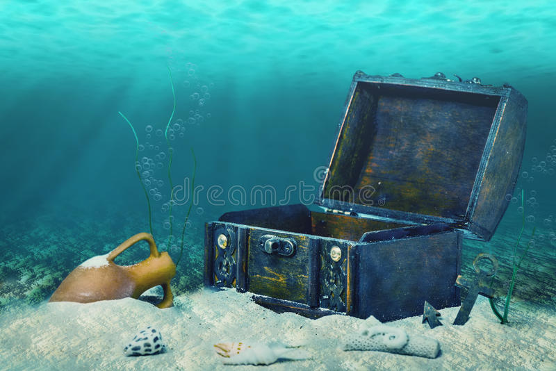 Beautiful collage of closed old wooden treasure chest submerged. Underwater world with anchor, amphora and light rays, close up stock photography