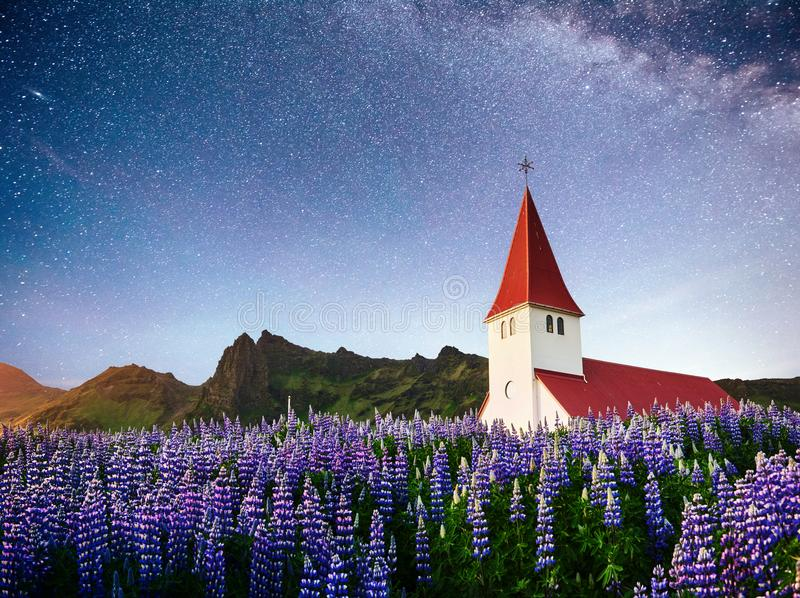 Beautiful collage Lutheran Church in Vik under fantastic starry sky. Iceland royalty free stock photo