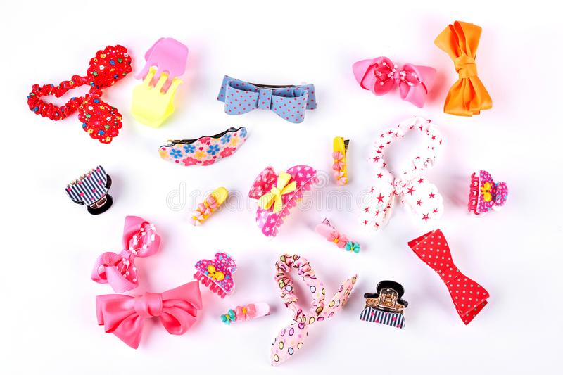 Beautiful collection of kids hair accessories. Set of different fashion hairpins and scrunchies for childrens on white background. Childrens stylish hairpins stock images