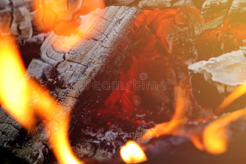 Beautiful color of burning red coals and black charred wood. Orange hot coals in the Russian stove. Red burning coals as a texture royalty free stock photography