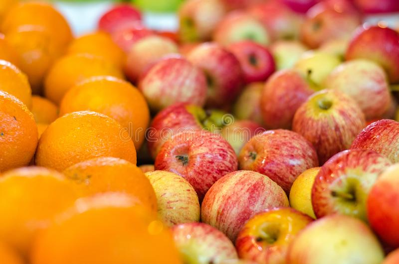 beautiful color combination, orange and red apple background display at market stall. stock photo