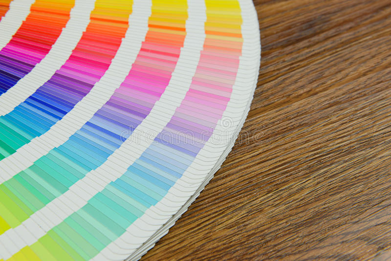 Beautiful color swatches book on table. Color, swatches, book, rainbow and paper on table stock photography